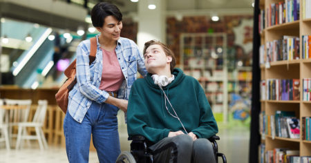 Mother with adult son in wheelchair